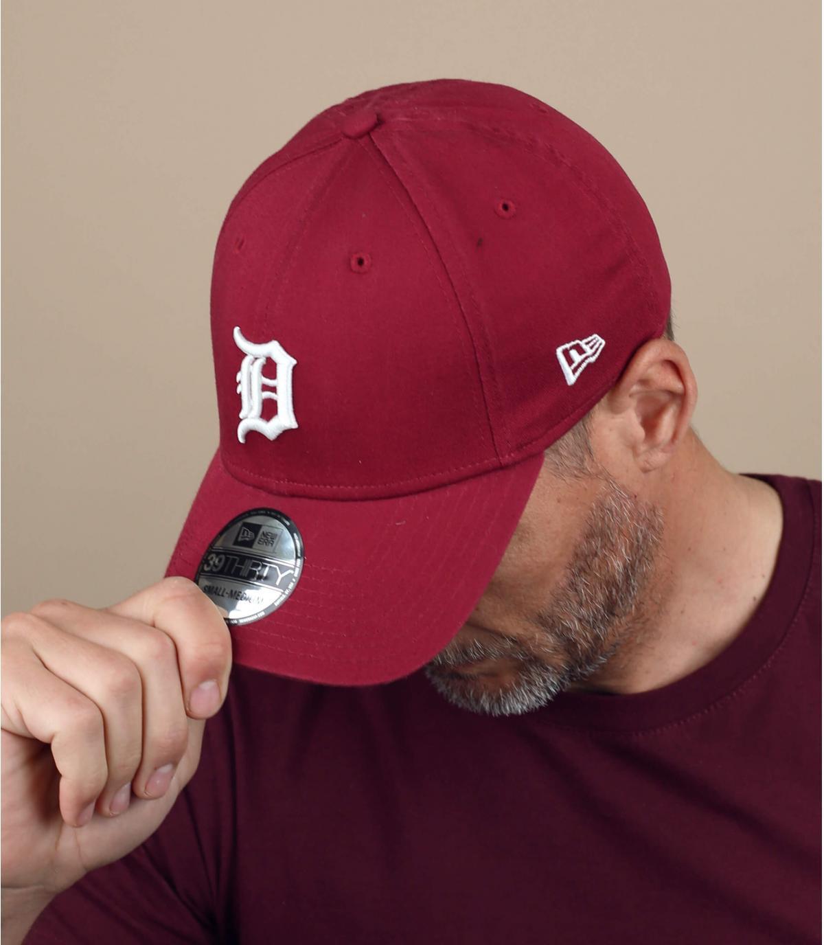 D burgundy cap