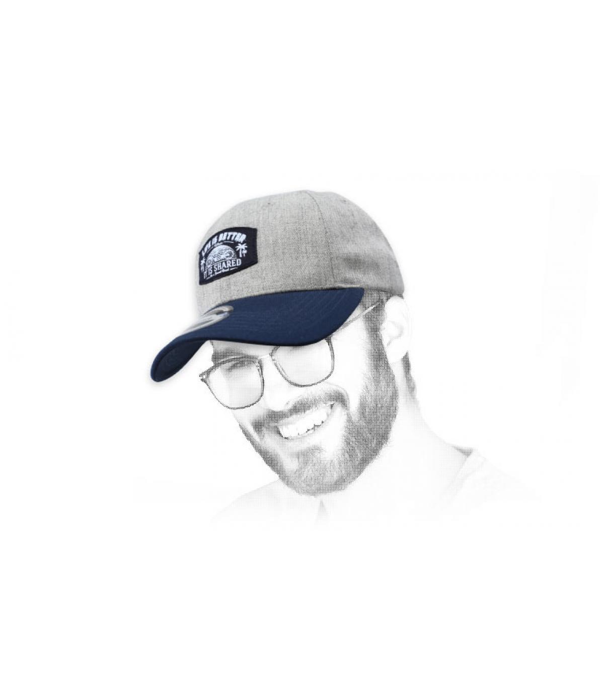 grey and blue bike cap
