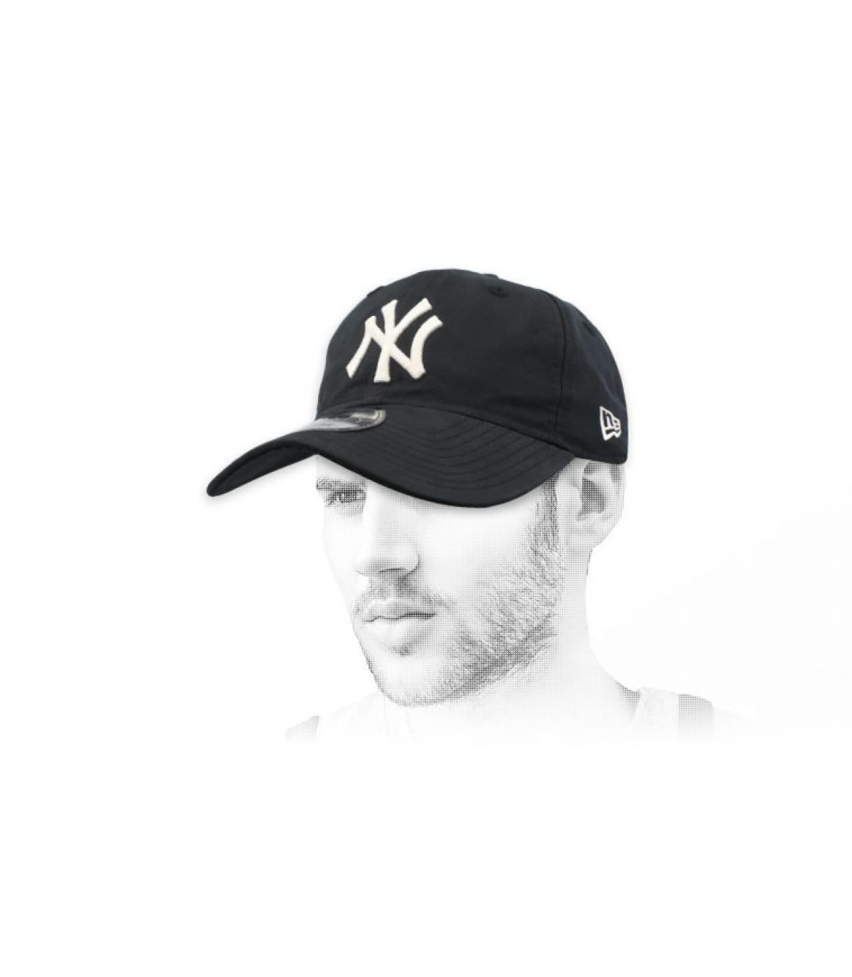 black packable NY cap