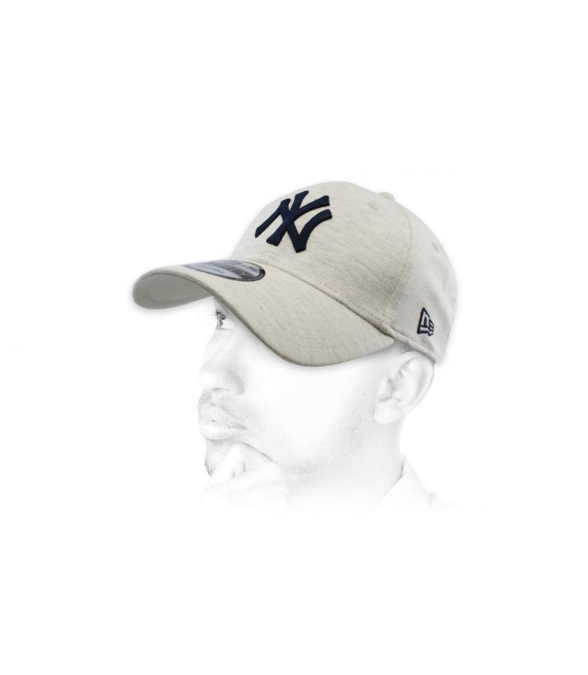 grey and blue NY cap