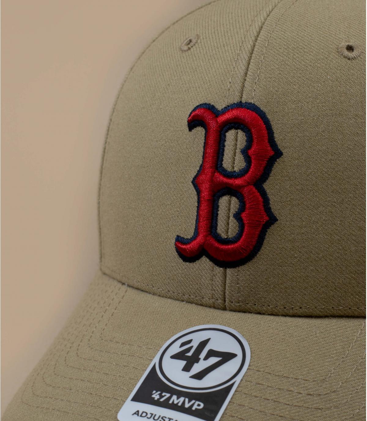 B beige cap