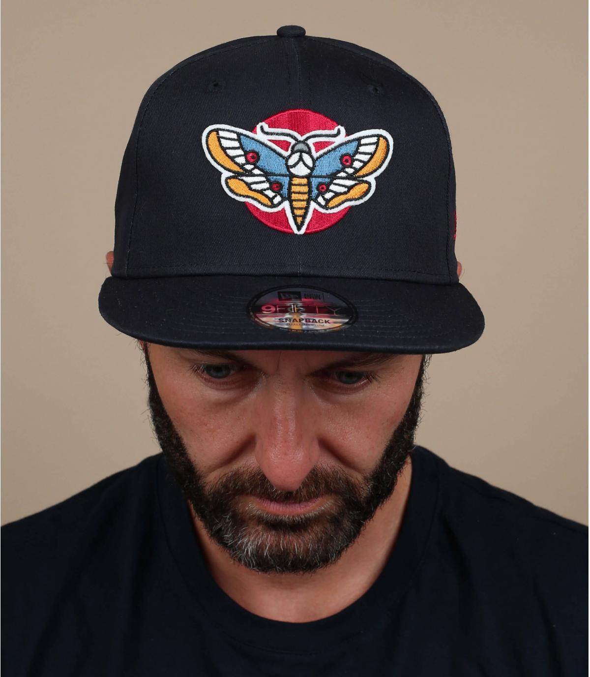 black butterfly cap
