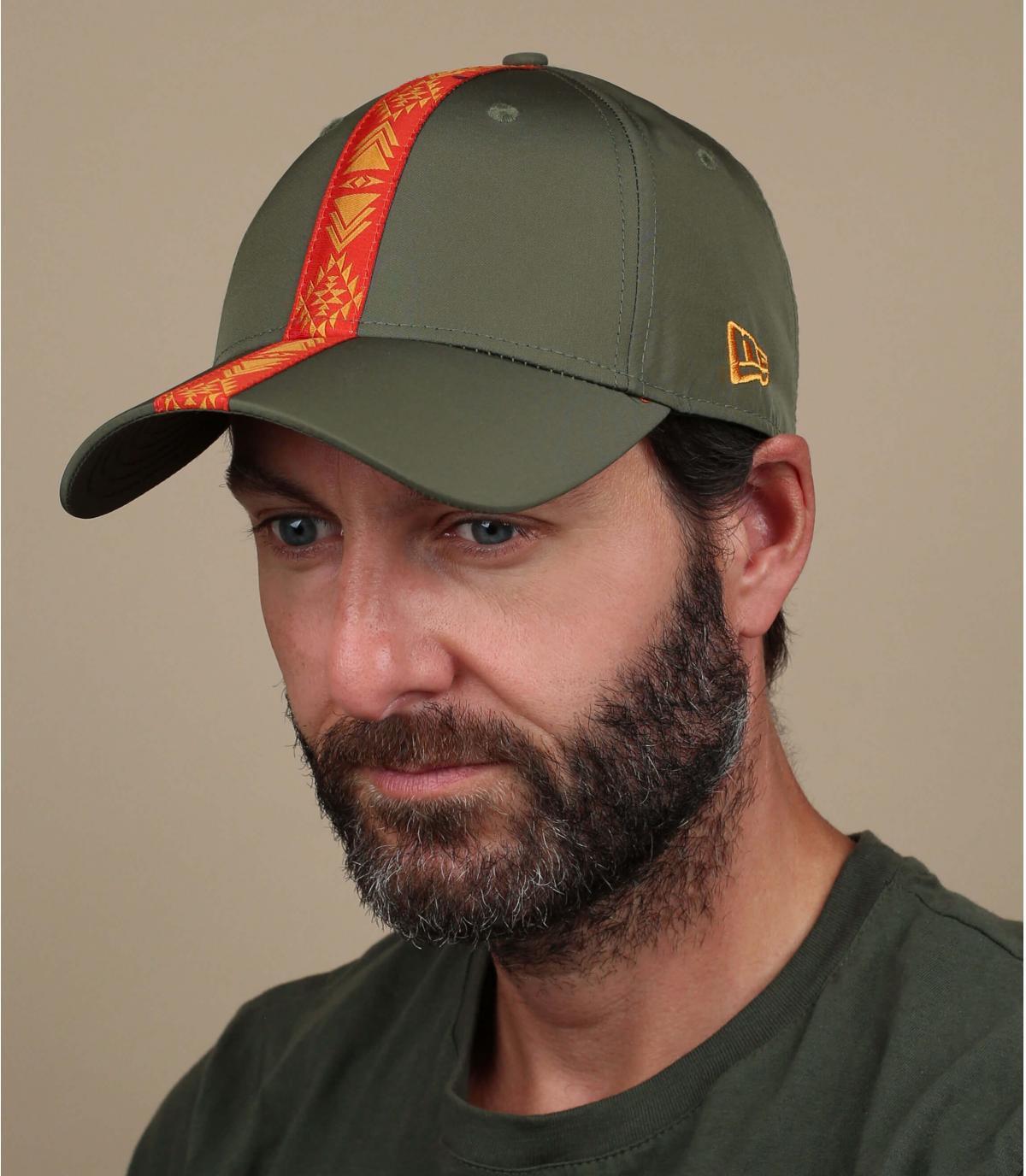 Green cap orange ribbon
