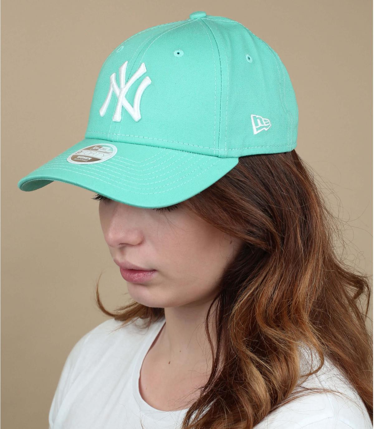 green NY cap woman