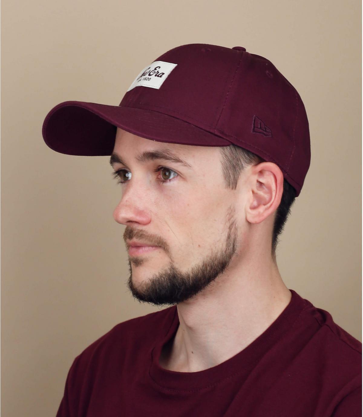 New Era burgundy cap.