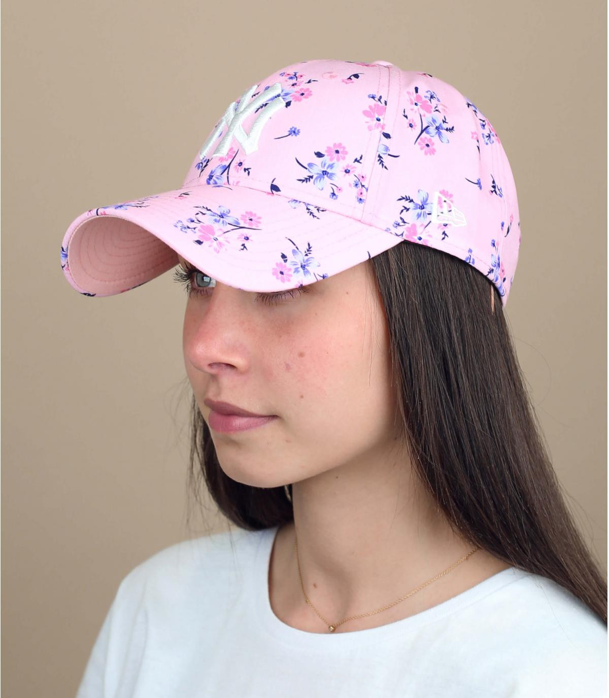 women pink cap flowers