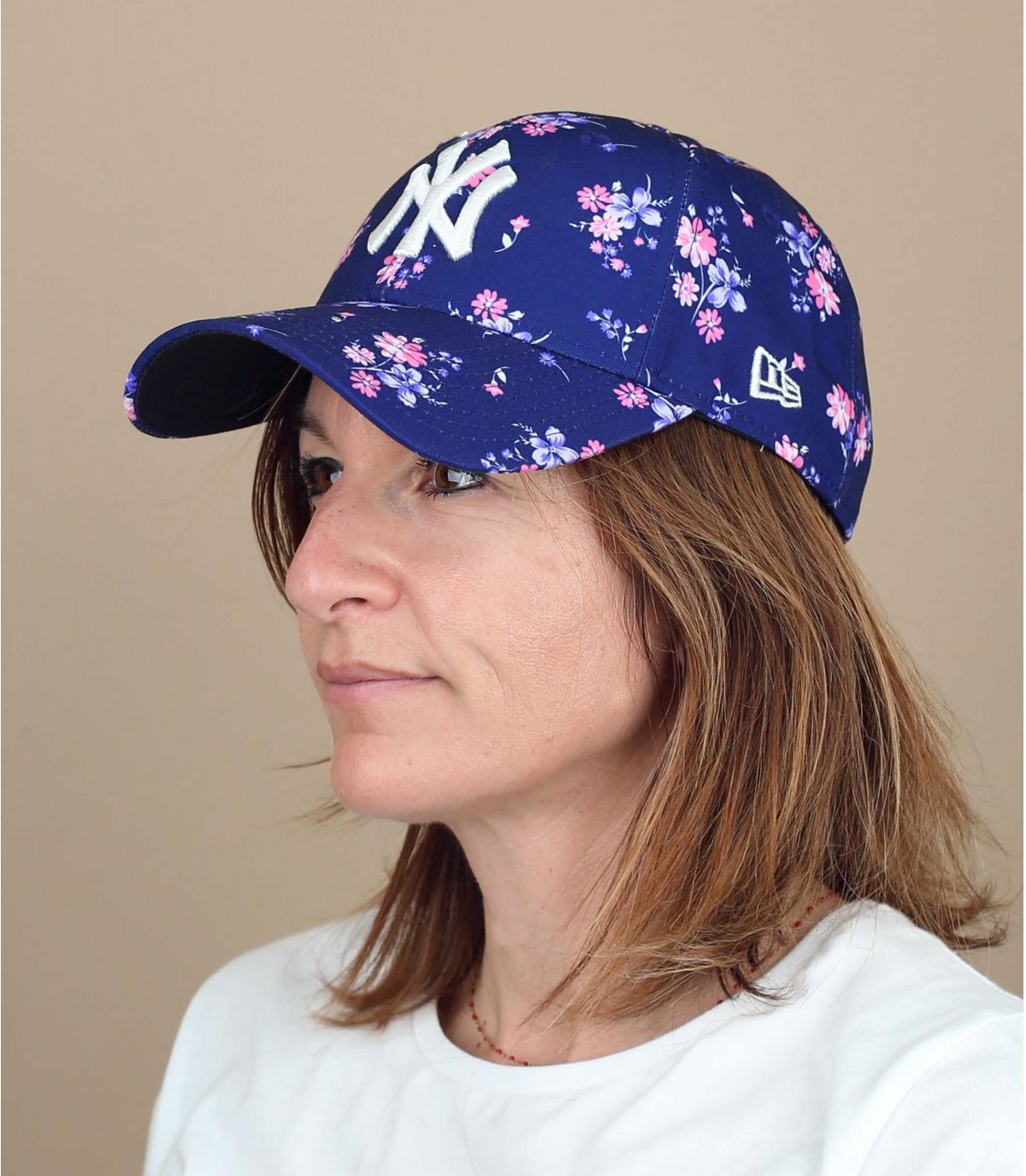 NY cap woman flowers