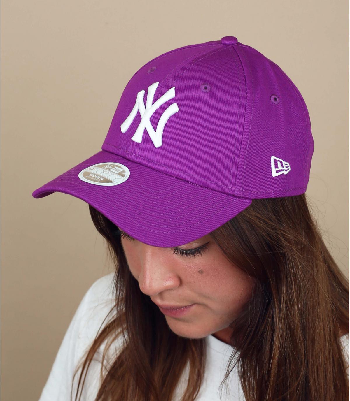 Purple NY cap woman