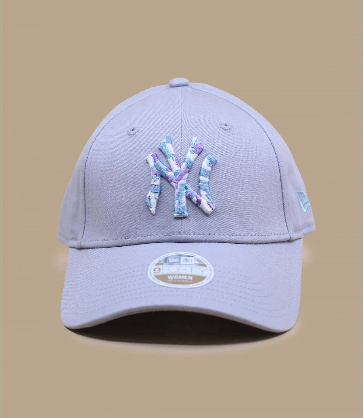 grey NY cap woman
