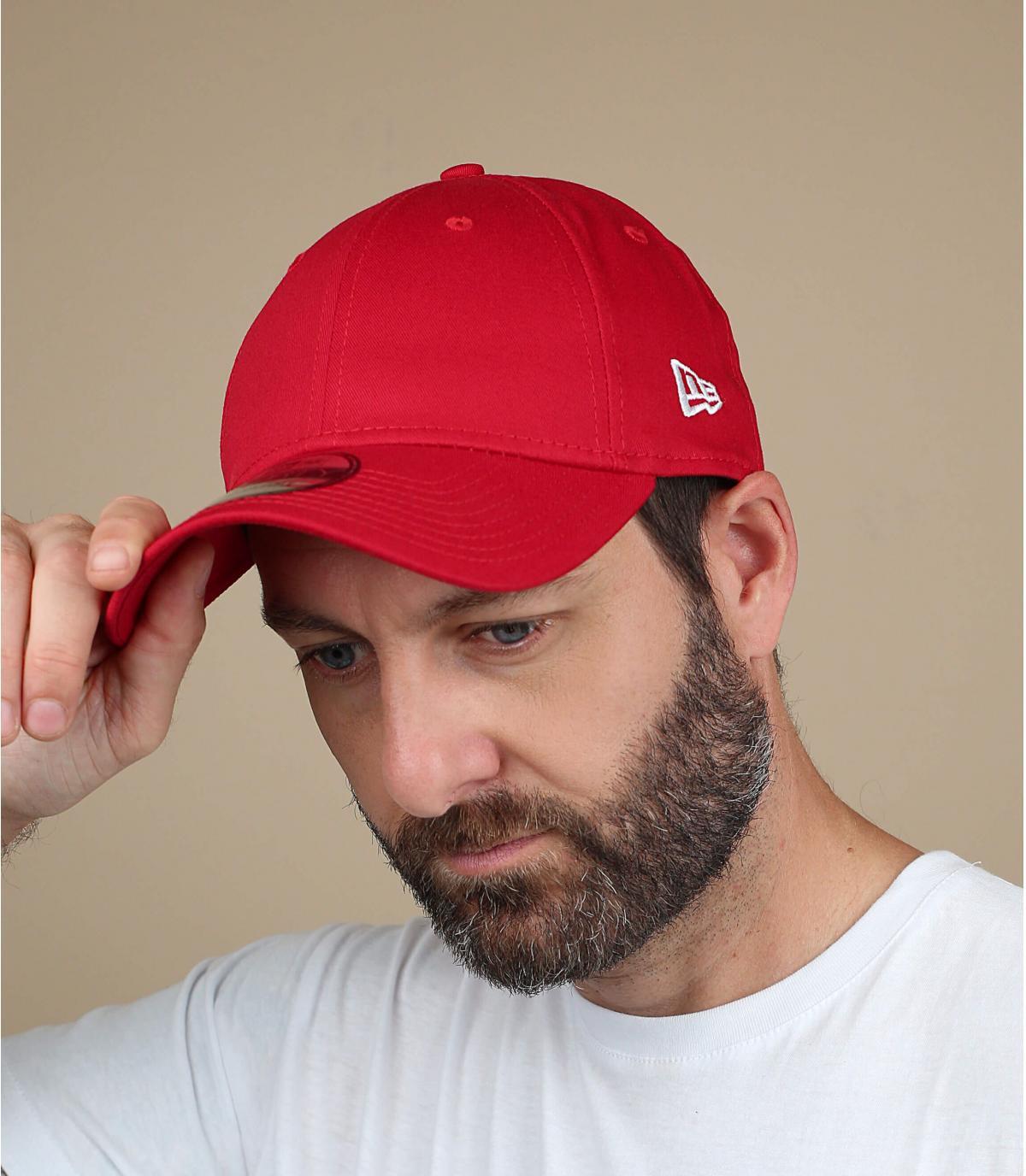 red curved visor cap