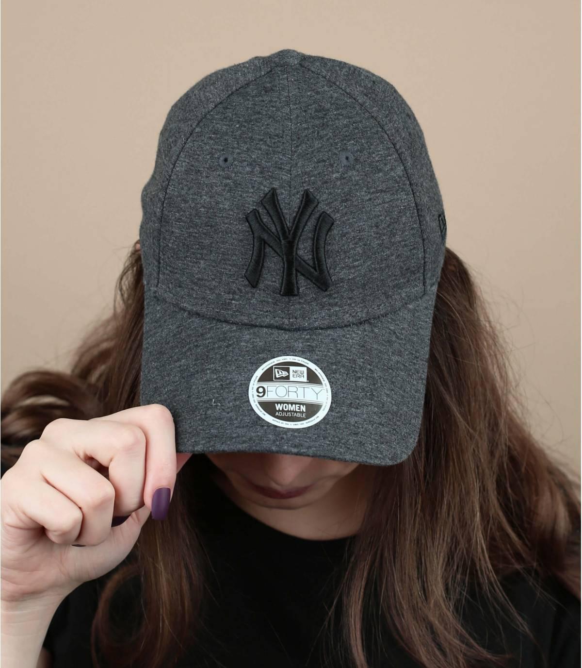 grey cap woman