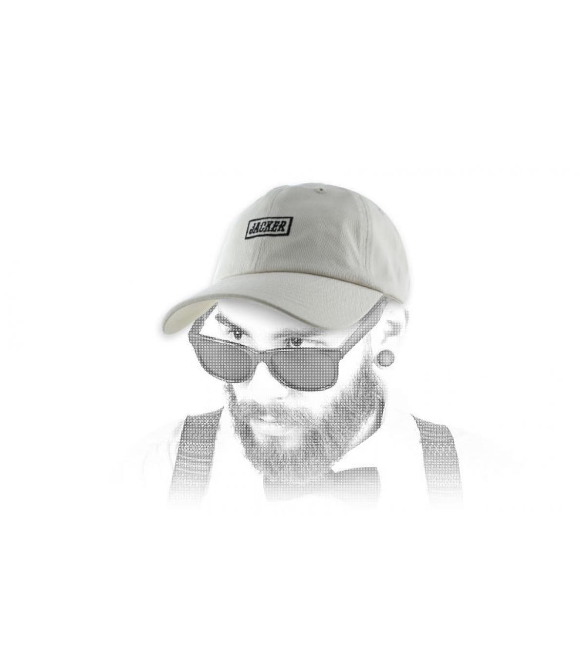 beige cap Jacker logo