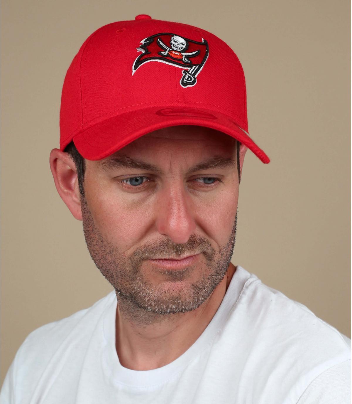 red and black Buccaneers cap.